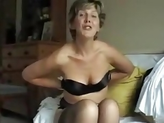 This 50-something mom takes off her brassiere and shows us her tits, squeezing them, profiling them, lifting 'em and playing with her nipples.
