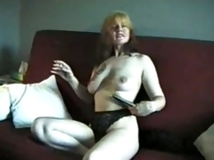 Mature smokes and shows us her titties