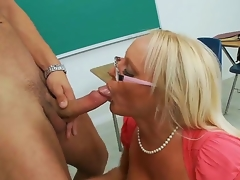 Charming spectacled blonde teacher Alexis Golden is having nice sex with her student Danny Mountain in this movie. She is kneeling and beginning to perform hawt fellatio.