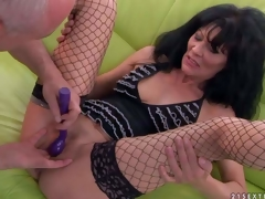 Long haired older brunette Regina in fishnet nylons spreads her sexy legs and then stud makes her squirt. She receives her hole finger fucked and her clit vibrated before this babe receives orgasm