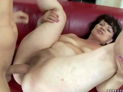 Helena May is s sex obsessed oldie with wet hairy pussy. Undressed experienced woman parts her legs on the edge of the daybed and gets her cookie drilled by her youthful hard dicked lover
