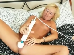 Taut body blonde aged gets in nature's garb and masturbates