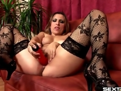 Red marital-device fills soaking wet mamma cunt