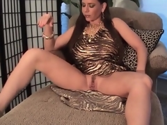 Busty milf in slutty dress pumps her pussy