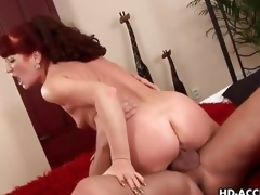 Aged redhead rides her pussy on this thick schlong