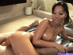 Oriental babe Asa Akira engulfing a guy's pecker after a horny nuru massage