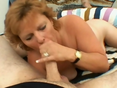 Lustful blonde grandmother Megan engulfing a large youthful prick with longing