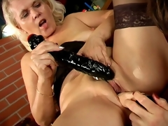 Trashy lesbian grannies Marketa And Leona licking their succulent twats and sharing a giant dildo
